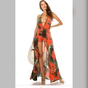 Halter neck sleeveless open back romper dress.